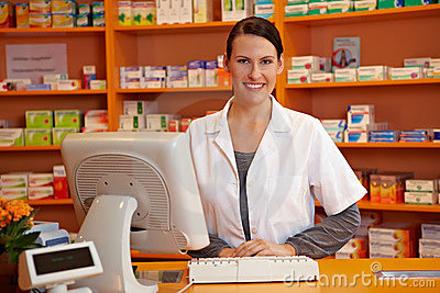 Pharmacist behind checkout counter