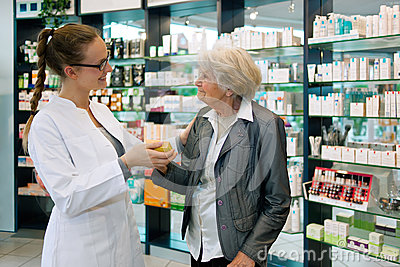 Pharmacist and grateful senior woman