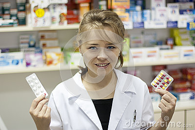 Pharmacist holding medication
