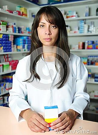 Pharmacist selling medicine