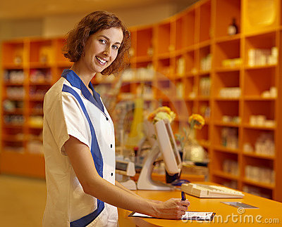 Pharmacist signing contract
