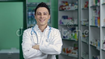Pharmacist standing with crossed arms in pharmacy stock footage