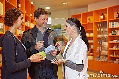 Pharmacist talking to couple