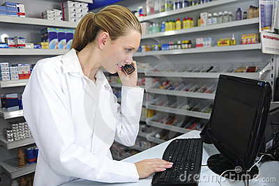 Pharmacist using computer