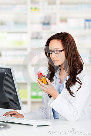 Pharmacist working on her computer