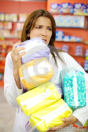 Pharmacist working in pharmacy holding packages