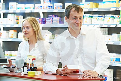 Pharmacy chemist workers in drugstore