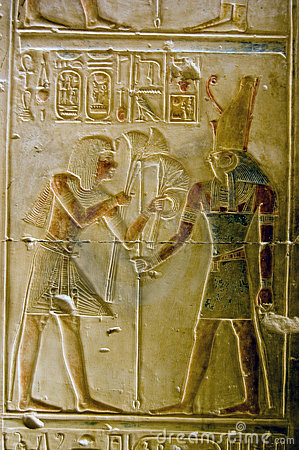 Pharoah Seti presenting lotus flowers to god Horus