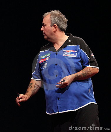 Phil Taylor throws the last dart. Editorial Photo