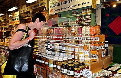 Philadelphia, PA: Woman Shopping at Reading Terminal Market Editorial Stock Photo