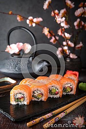 Free Philadelphia Roll Sushi With Salmon, Cucumber, Avocado, Cream Cheese, Tobiko Caviar. Sushi Menu. Royalty Free Stock Photography - 123454007