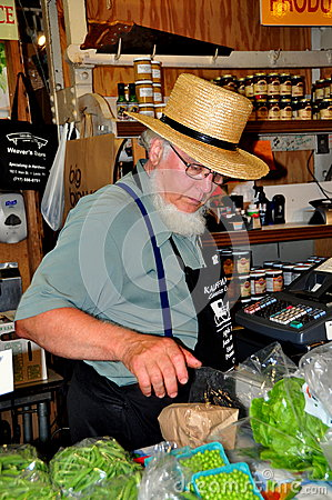 Philadelpjhia, PA: Amish Man Selling Food at Market Editorial Image