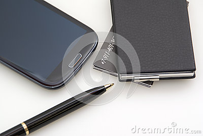 Phone, cards, pen. Everything of black colour