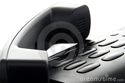 Phone Handset on Hold over Slick Telephone Keypad