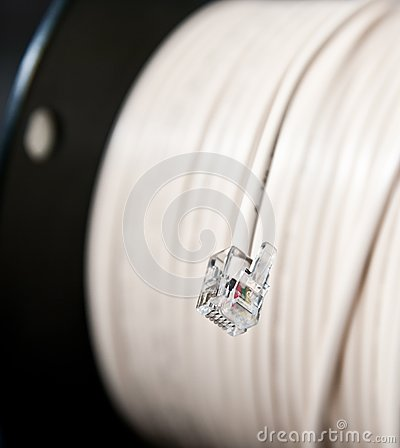 Phone jack and telephone cord on a roll