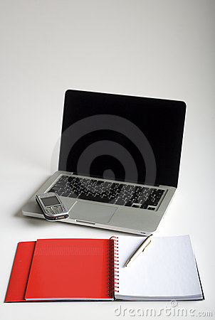 Phone, laptop and empty notebook