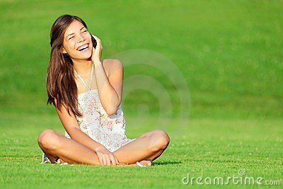 Phone woman laughing in park