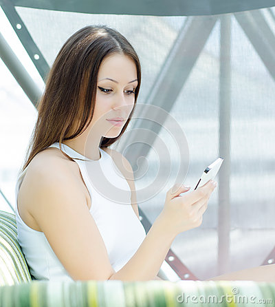 Phoning woman sitting relaxed at cafe
