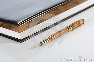 Photo album and pen