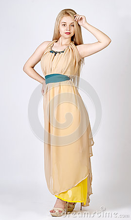 Photo of beautiful young lady in original dress