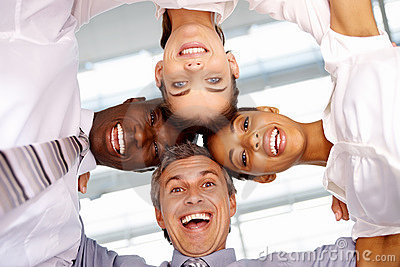 Photo of business colleagues with heads together