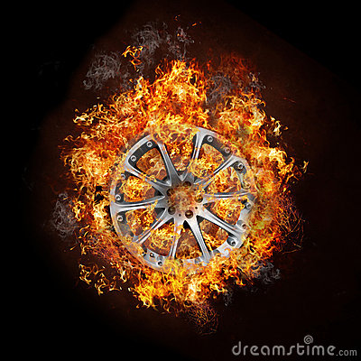 Photo of a car wheel on burning fire