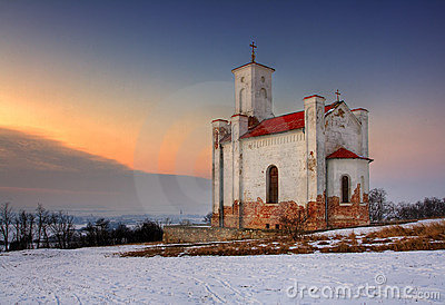 A photo of a catholic church in wintertime