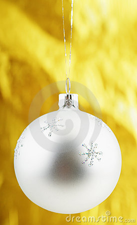 Photo of Christmas ball over golden background