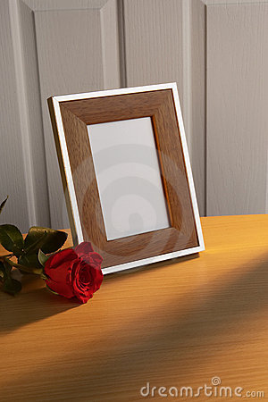 Photo frame with red rose
