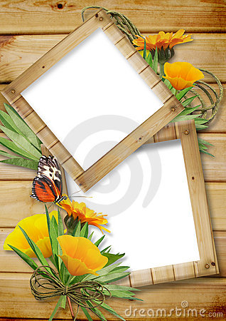 Photo frame on a wooden background with butterflie