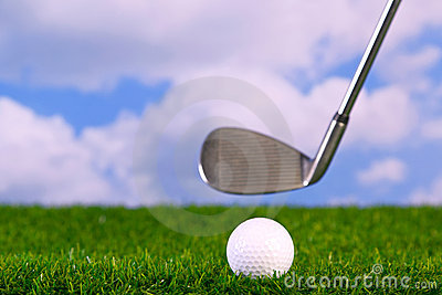 Photo of a golf club hitting ball