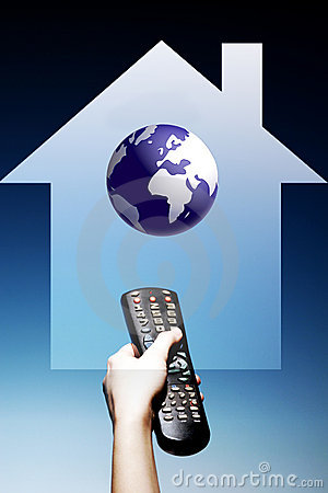 Photo of Hand Holding Television Remote Control in The Home from
