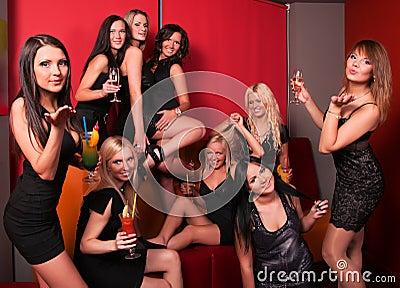 Photo of joyful beautiful friends on the party