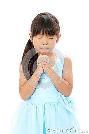 Photo of little asian girl praying