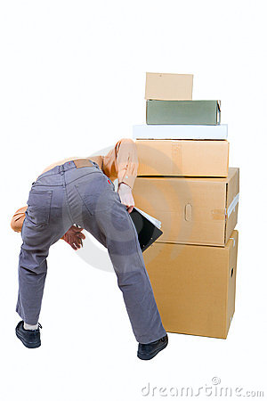 Photo of a man stooped over the boxes