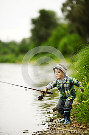 Free Photo Of Little Boy Fishing Stock Photo - 28251580