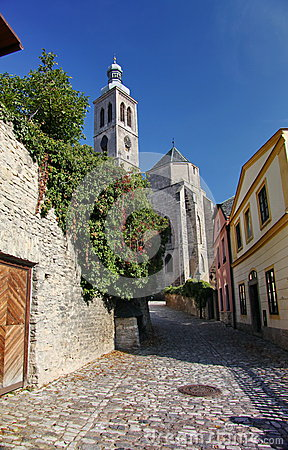 Free Photo Of The Old Narrow Cobblestone (natural Stone) Streets Of Medieval European Small Town, Going To An Ancient Catholic Church. Stock Photos - 53542693