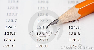 Photo of pencil on a table with nimbers