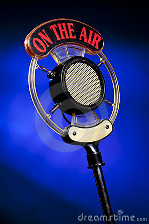 http://thumbs.dreamstime.com/x/photo-radio-microphone-blue-background-14648661.jpg