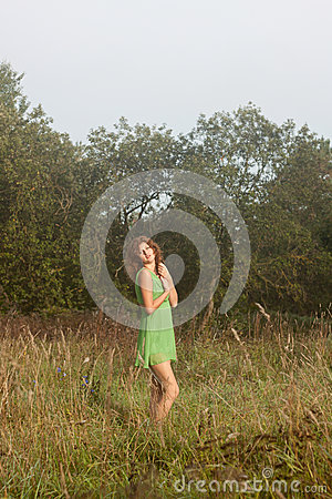 Photo of romantic woman in fairy forest.