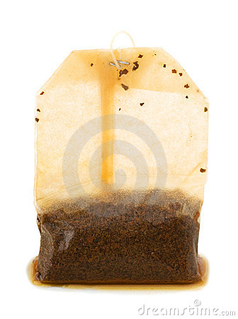 Photo of used teabag over white background