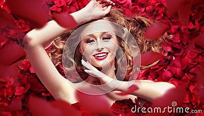 Photo of woman and downward petals