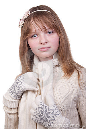 Photo of a young girl in white sweater with scarf
