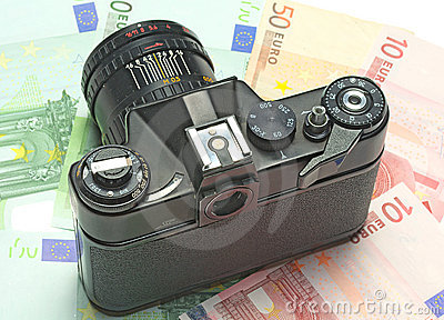 Photocamera lying on the euros