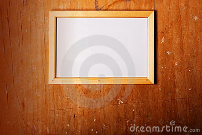Photoframe on wooden background
