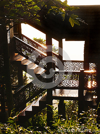 Thai traditional timber house details in sunlight