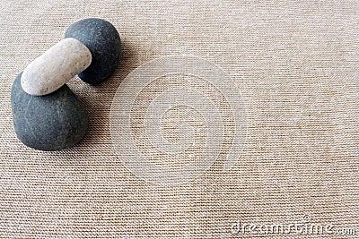 Pebbles and linen, zen textures background