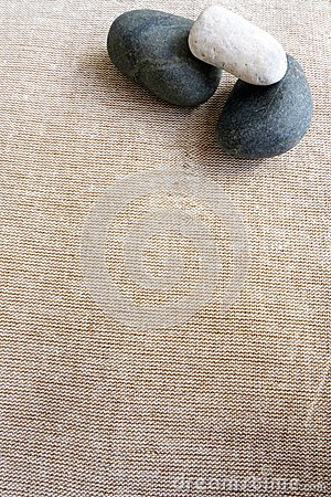 Pebbles and linen, zen textures background