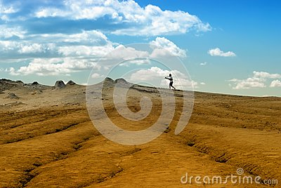 Photographer on arid landscape