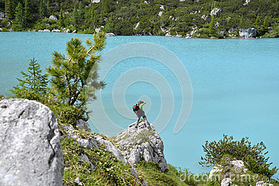 Photographer and blue lake